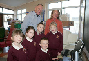 Marion Tobin, principal, Southill Junior School and second class pupils Sophie Bannon, Dion Moore, Daniel Joyce, Hazel Moore and Mark Crawford showing their computer skills to Billy Higgins during his recent visit to the school.